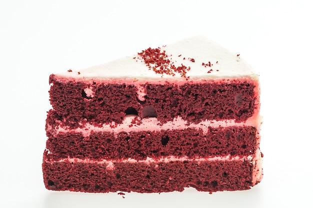 Czerwonego aksamitu ciasta na białym tle