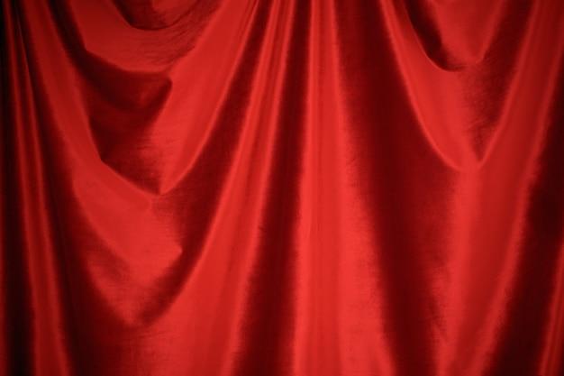 Czerwony aksamitny tkaniny tła zakończenie up