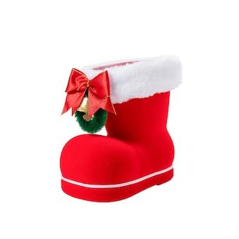 Czerwony but świętego mikołaja na białym tle
