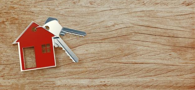 Czerwony dom z kluczami na drewnianym banerze w tle
