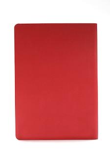 Czerwony dzienniczek odizolowywający na białym tle