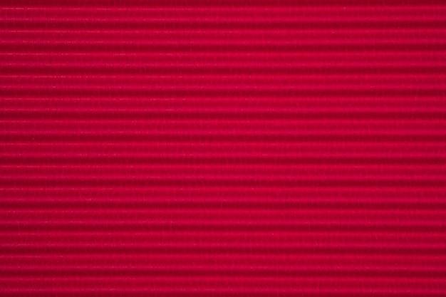 Czerwony falistej tekstury papieru tło