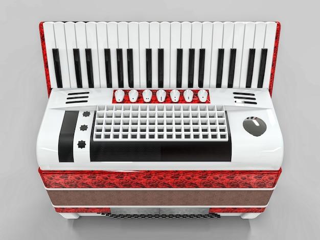 Czerwony i biały akordeon na szarym odosobnionym tle
