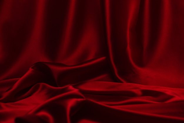 Czerwony jedwab lub satyna luksusowe tkaniny tekstury można użyć jako abstrakcyjne tło. widok z góry