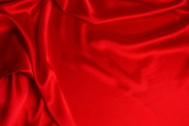 Czerwony jedwab lub satyna luksusowe tkaniny tekstury można użyć jako abstrakcyjne tło. widok z góry.