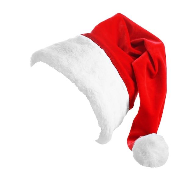 Czerwony kapelusz świętego mikołaja na białym tle, z bliska
