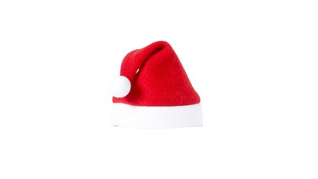 Czerwony kapelusz świętego mikołaja na białym tle.