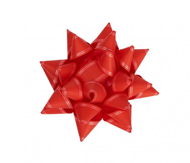 Czerwony łęk od czerwonego dekoracyjnego papieru odizolowywającego na białym tle