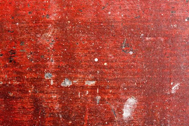 Czerwony malowane porysowany deska drewno tło, tekstura. zdjęcie w wysokiej rozdzielczości.
