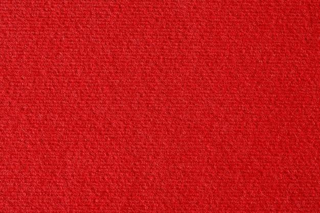 Czerwony papier w linie tekstury lub tła. zdjęcie w wysokiej rozdzielczości.