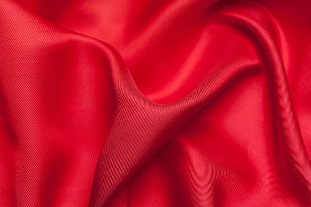 Czerwony płótno macha tło teksturę