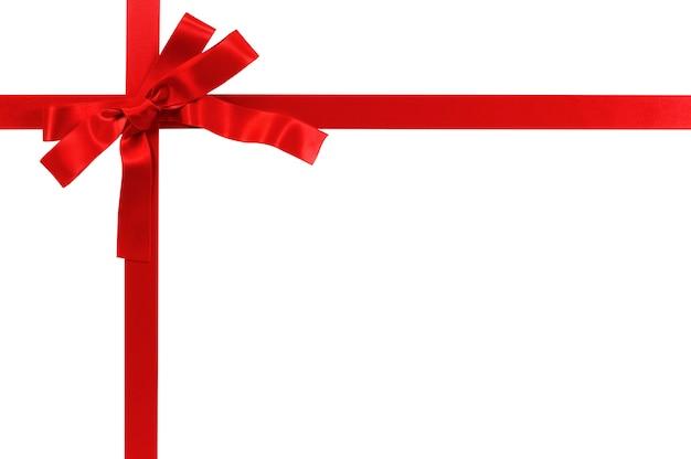 Czerwony prezenta łęk i faborek odizolowywający na białym tle