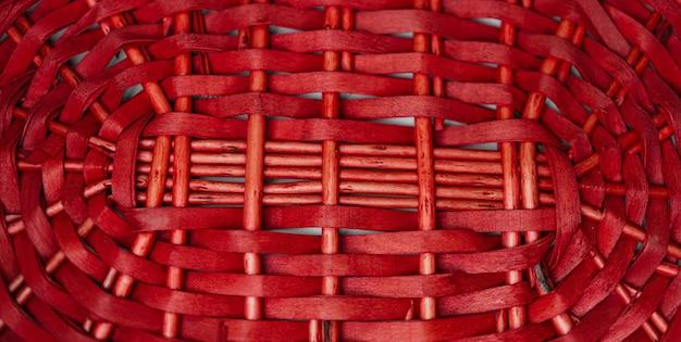 Czerwony splot tekstury kosza na tle