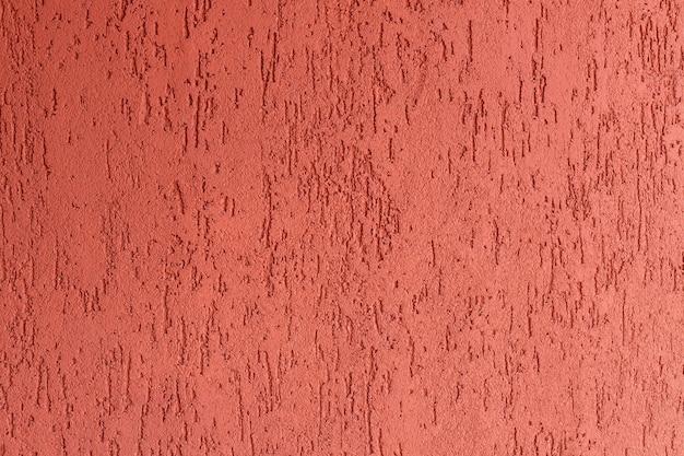 Czerwony szorstki tynk cementowy ściana stiukowa tekstura ścienna