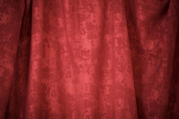 Czerwony textured zasłony tła zakończenie up
