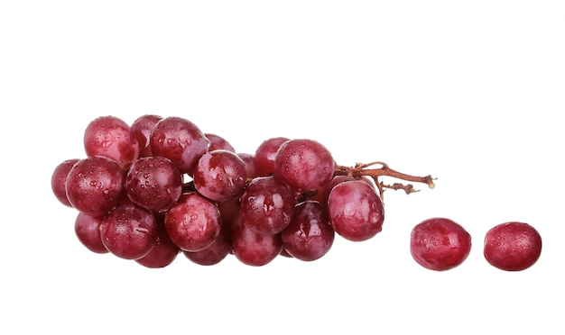Czerwony winogrono odizolowywający na bielu