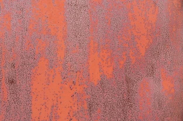 Czerwony zardzewiały teksturowanej metalowe tło. kopiuj przestrzeń dla projektantów.