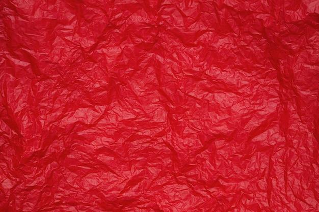 Czerwony zmięty papier lub arkusz tekstura tło dla projektu. tapeta na tekst. skopiuj miejsce.