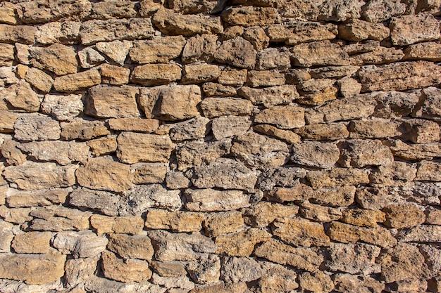 Część średniowiecznej kamiennej ściany, tła lub tekstury