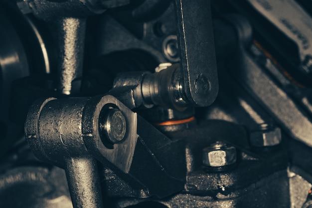 Częścią złożonego mechanizmu jest zbliżenie. mechanizm vintage. urządzenie retro.