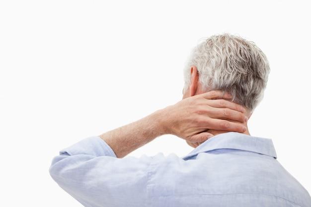 Człowiek mający ból szyi