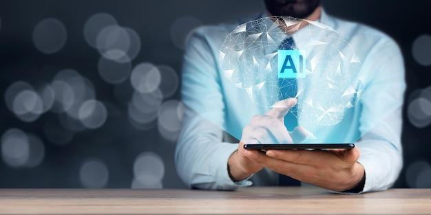 Człowiek posiadający cyfrowy tablet z ikonami ai