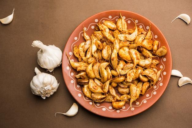 Czosnek fry lub tala hua lahsun w hindi, to popularny dodatek lub przekąski z maharashtra w indiach