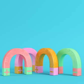 Cztery kolorowe magnesy na jasnym niebieskim tle