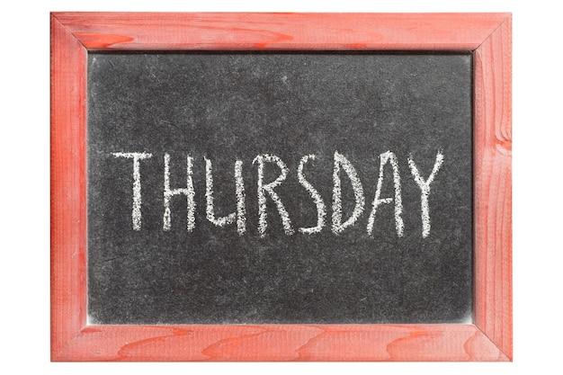Czwartek słowo odręcznie na izolowanej rocznika tablicy