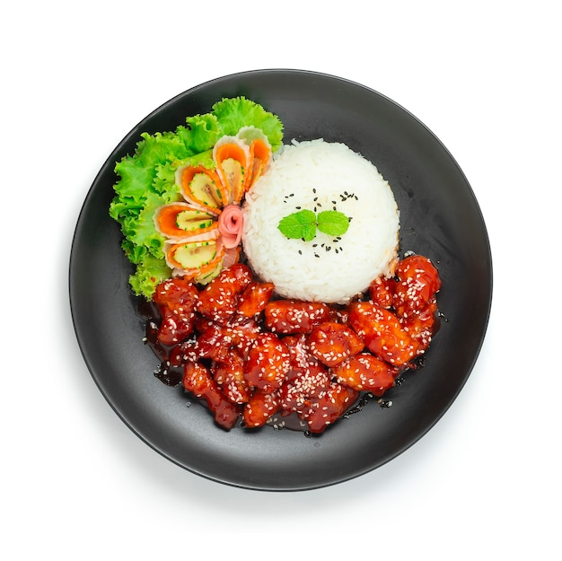 Dakgangjeong fried chicken with spicy and sweet sauce posyp sesame