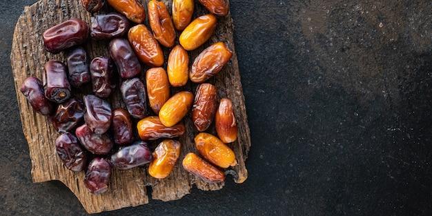 Daktyle owoce słodkie owoce suszone zdrowe smaczne przekąski potrawy wegańskie lub wegetariańskie