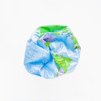 Deflated ball with earth map
