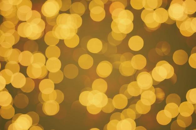 Defocused abstrakta lub złota błyskotliwości bokeh od choinek elektryczności lekkich dekoracj
