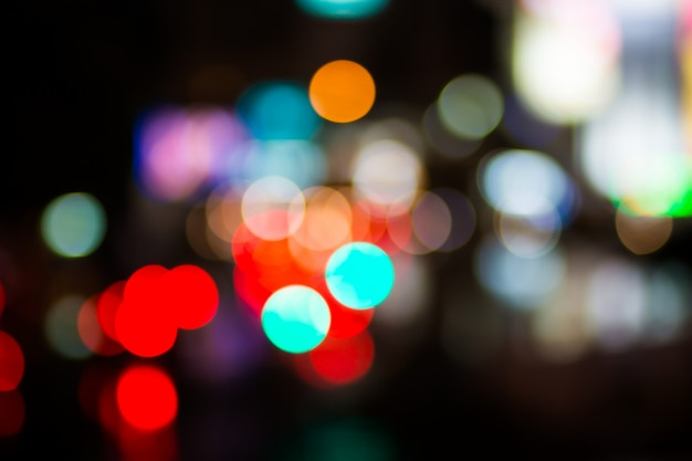 Defocused boże narodzenie pomarańczowy żółty bokeh biały kolor światła rozmycie tła miasta w partii światła noc