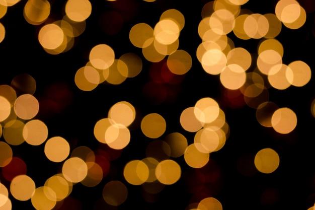Defocused lub złoty światło błyskotliwości bokeh od choinek elektryczności dekoracj