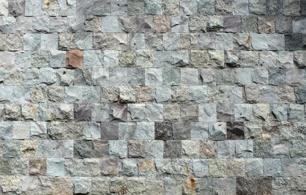 Dekoracyjna Kwadratowa Kamienna ściana Z Cegieł Tekstura Premium Zdjęcia