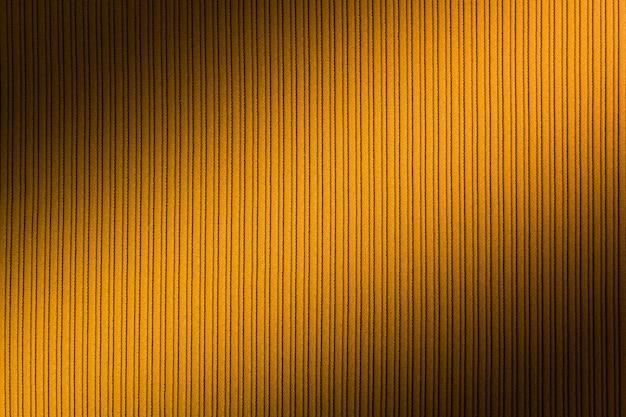 Dekoracyjna przestrzeń żółty kolor, prążkowana tekstura przekątnej gradientu. tapeta. sztuka. projekt.