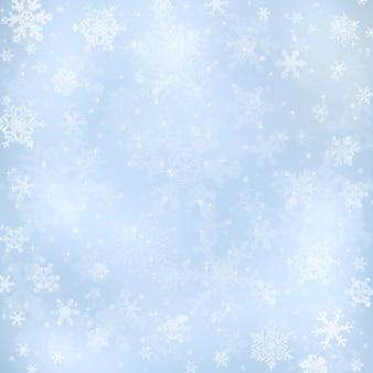 Dekoracyjne niebieskie tło bożego narodzenia ze światłami bokeh i płatkami śniegu