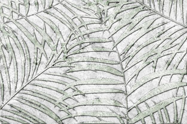 Dekoracyjne płytki kamienne z wzorem tropikalnych liści i fakturą naturalnego marmuru. element projektu. tekstura tła