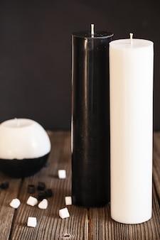 Dekoracyjne ręcznie robione świece w kształcie kuli i cylindra