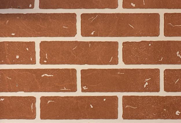Dekoracyjny pomarańczowy ściana z cegieł, tło lub tapeta