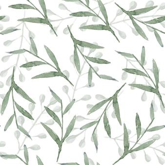 Delikatny, nakładający się wzór akwareli zieleni z bałaganem jasnozielonych liści i gałęzi na białym tle