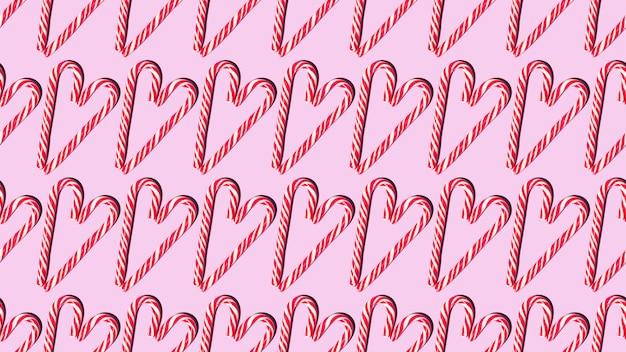 Deseń bez szwu czerwone i białe boże narodzenie laski cukierki w formie serca