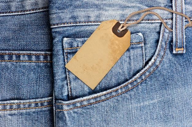 Detal z dżinsów i metki z etykietą szczegóły z niebieskich dżinsów szczegóły z dżinsów