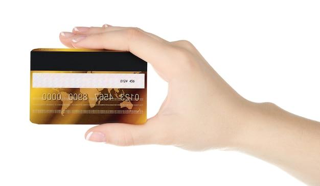 Dłoń trzymająca kartę kredytową, na białym tle