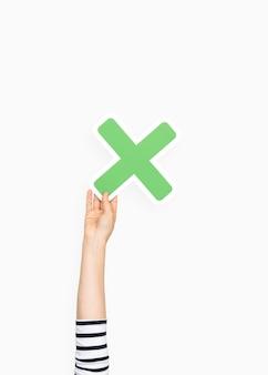 Dłoń trzymająca symbol mnożenia