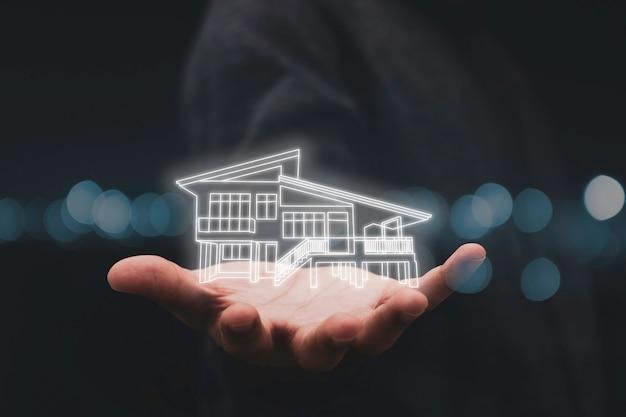 Dłoń trzymająca wirtualny dom