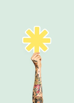 Dłoń trzymająca znak gwiazdki