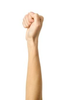 Dłoń zaciśnięta w pięść. obraz pionowy. kobieta ręka z francuskim manicure gestykuluje na białym tle na białym tle. część serii
