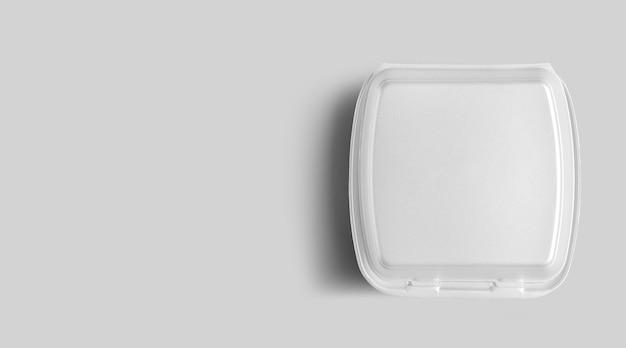 Do góry widok pustego białego styropianu na szarym tle. koncepcja obiad ekologicznej żywności.
